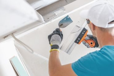 painter applying plaster to the walls
