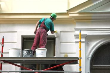 exterior of a building being painted
